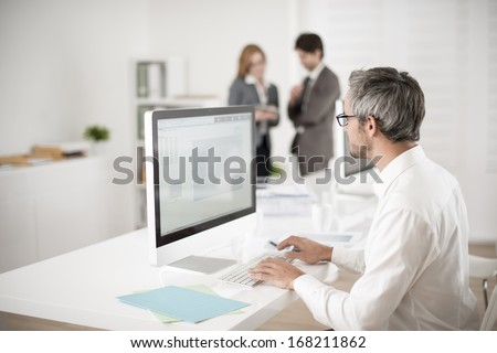 businessman works on his computer on workplace - stock photo