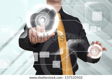 Businessman works with high tech screen. - stock photo