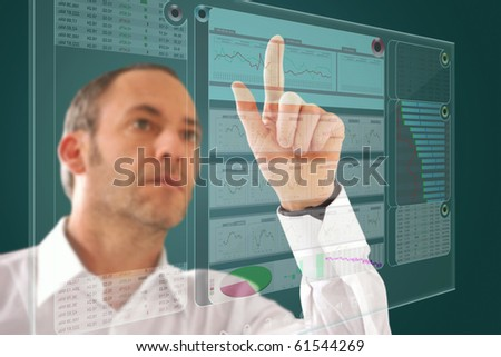 Businessman works with huge computer display