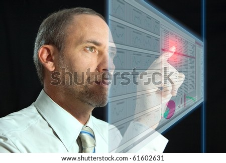 Businessman works with huge LCD panel - stock photo