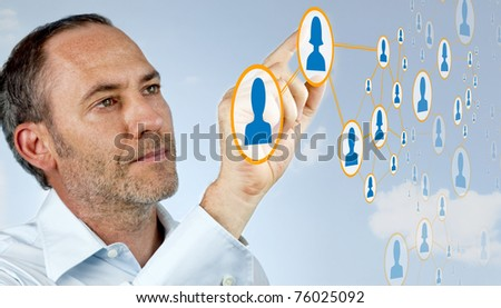Businessman works with social network - stock photo