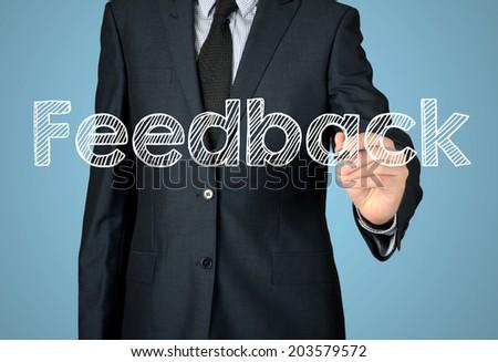 businessman write feedback - stock photo