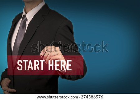 Businessman write Start here word for stat to success in business position. - stock photo