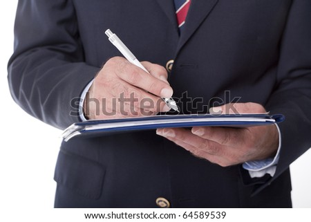 businessman writing and doing paperwork