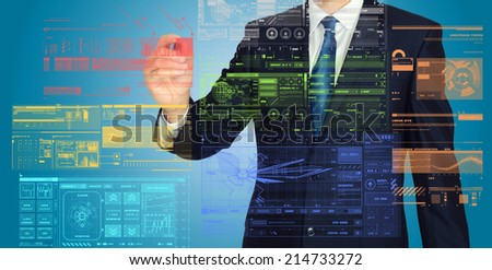 businessman writing and drawing graphs and diagrams on blue background  - stock photo