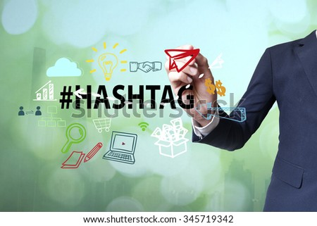 Businessman writing and drawing hashtag concept on blurred abstract background , business concept  - stock photo