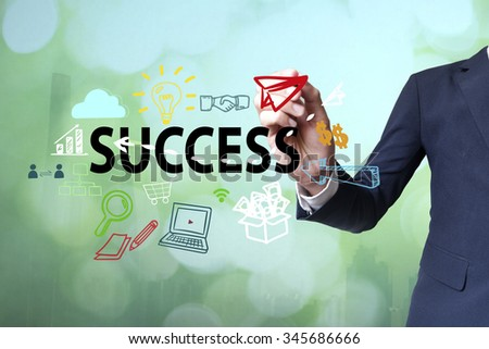 Businessman writing and drawing success concept on blurred abstract background , business concept - stock photo