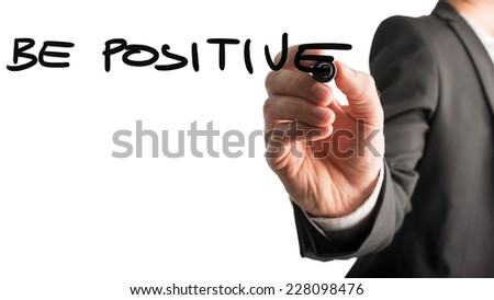 Businessman writing - Be Positive - with a black marker pen on a virtual screen over white with plenty of copyspace in an inspirational concept. - stock photo