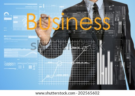 businessman writing business concept and drawing some diagrams and graphs