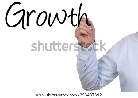 Businessman writing business growth with his hand with copyspace - stock photo