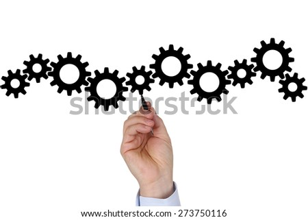 Businessman writing business plan for success, team, growth and moving gear wheels - stock photo