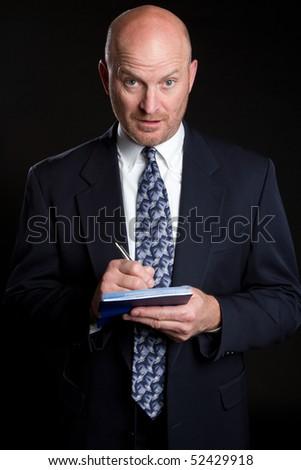 Businessman Writing Check - stock photo