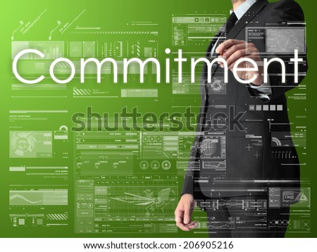 businessman writing commitment and drawing graphs and diagrams on green background