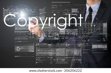 businessman writing Copyright and drawing some sketches  - stock photo