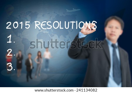 Businessman writing, drawing 2015 resolution on the screen.  - stock photo