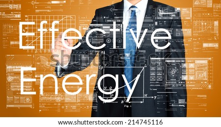 Businessman writing effective energy on background with some diagrams and sketches - stock photo