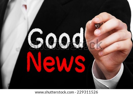 Businessman writing Good News on transparent board - stock photo
