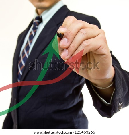 Businessman writing growing graph in studio - stock photo
