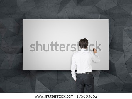 Businessman writing in a whiteboard - stock photo