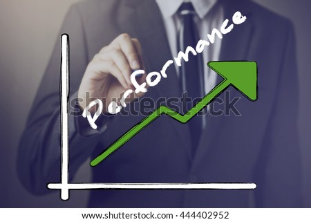 Businessman writing increasing positive Performance chart upward - indicates better performance measure such as company, sales, employee, management, income, etc. - stock photo