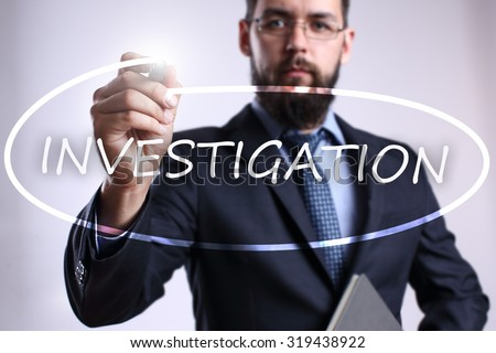 "Businessman writing ""Investigation"" with marker on transparent board. Business, internet, technology concept. - stock photo"