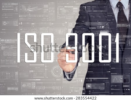 businessman writing ISO 9001