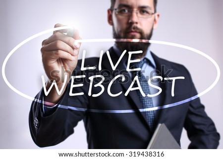 "Businessman writing ""Live webcast"" with marker on transparent board. Business, internet, technology concept. - stock photo"