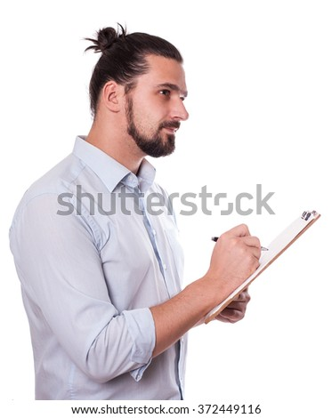Businessman Writing on a Clipboard, Isolated. Young Man  with Hair Bun. Stock image