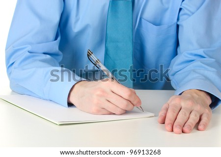 Businessman writing on document