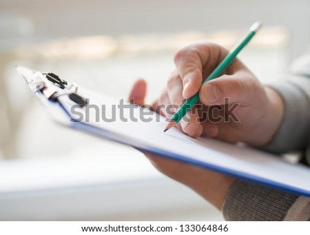 Businessman writing on the document table - stock photo