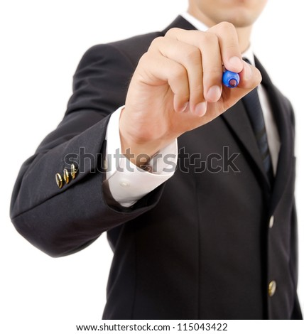 Businessman writing on the whiteboard, Selective focus on the pen. - stock photo