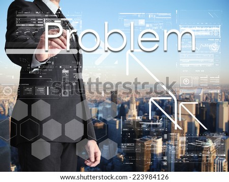 businessman writing Problem on transparent board with city in background - stock photo