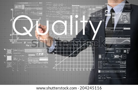 businessman writing Quality and drawing some sketches - stock photo