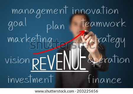 businessman writing revenue growth by business many processes - stock photo