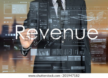 businessman writing revenue in the background is a city landscape - stock photo