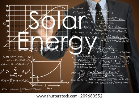 businessman writing technological terminology on virtual screen with modern business or technology background - Solar Energy - stock photo