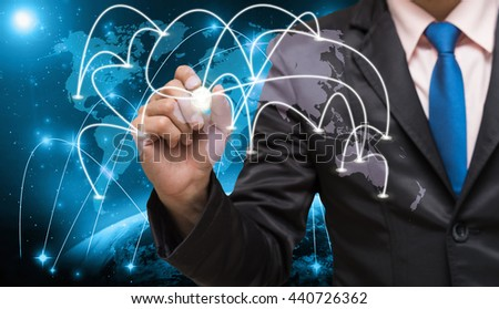 Businessman writing the center point of connection line of global network on world map with Part of earth network line background, business connection concept,Elements of this image furnished by NASA - stock photo