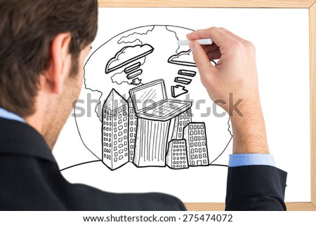 Businessman writing with a white chalk against blackboard with copy space - stock photo
