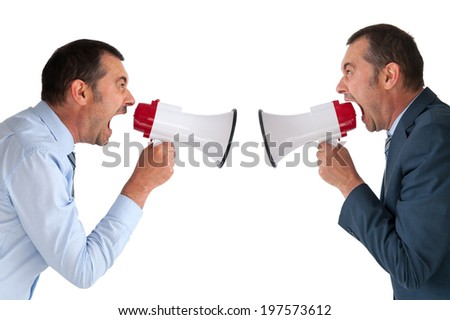 businessman yelling at himself through a loudhailer - stock photo