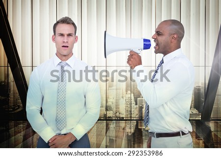 Businessman yelling with a megaphone at his colleague against window overlooking citty - stock photo