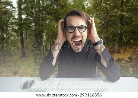 Businessman yelling with his hands on face against scenic view of walkway along lush forest - stock photo