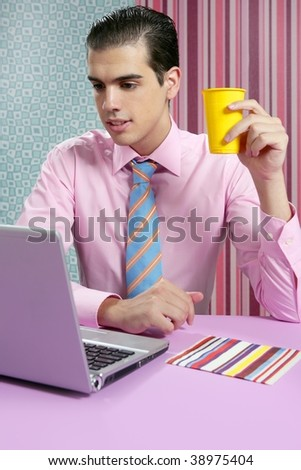 Businessman young eating fast food menu at office with laptop - stock photo