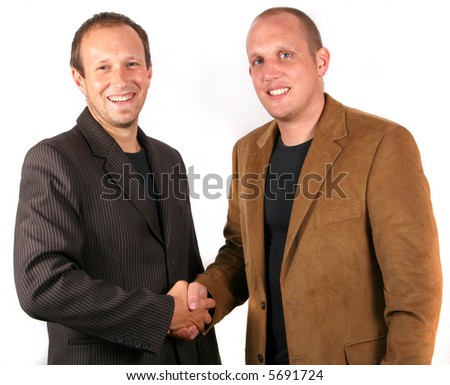 Businessmen Agreeing Two you businessmen shaking hands. Isolated studio shot! - stock photo
