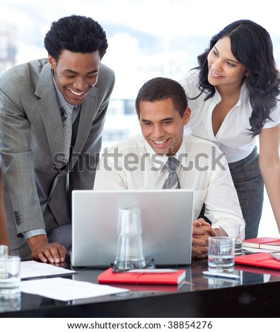 Businessmen and businesswoman working together in office - stock photo