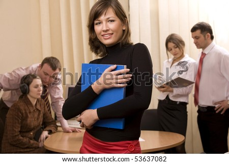 Businessmen and businesswomen at office and leader at front - stock photo