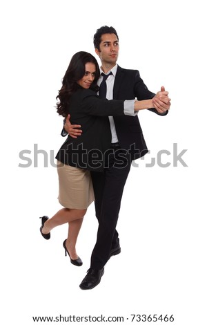 Businessmen and Businesswomen tangoing in the studio - stock photo