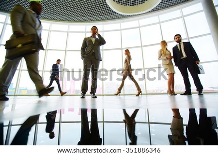 Businessmen and businesswomen working at office - stock photo