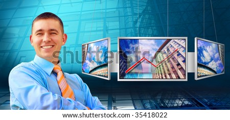 Businessmen and monitors with business architecture background - stock photo