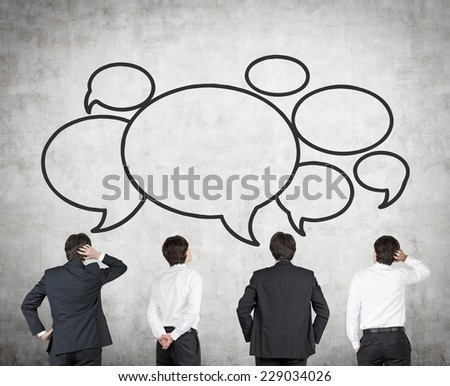 Businessmen and speech bubbles  - stock photo