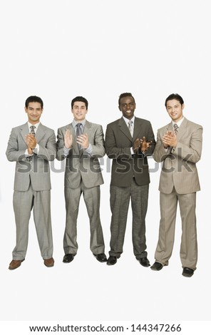 Businessmen applauding
